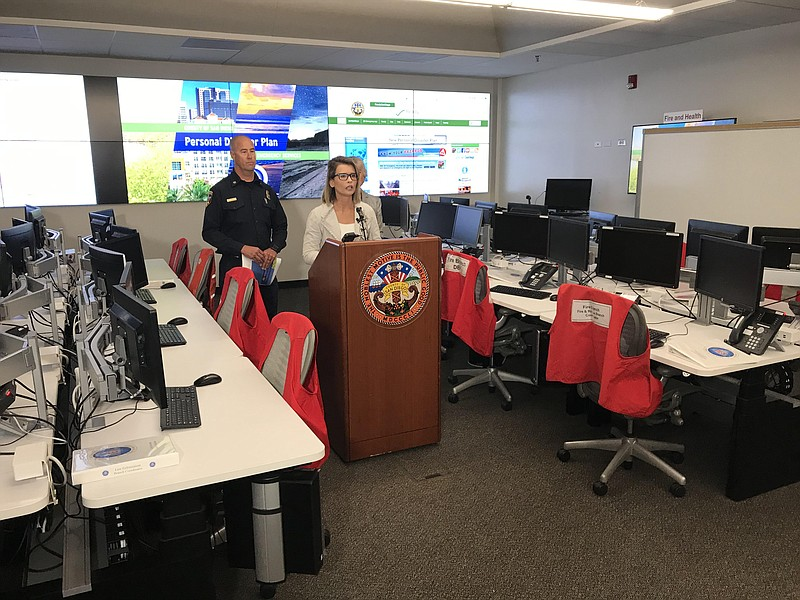 Holly Porter with the Office of Emergency Services speaks at a press conferen...