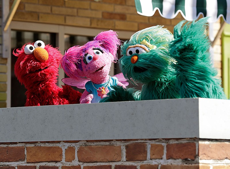 In this Tuesday, March 26, 2019 photo, Sesame Street characters from left, El...