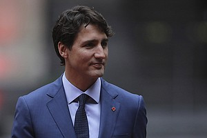 In Canadian Vote, Trudeau's Liberals On Top, But Lose Abs...