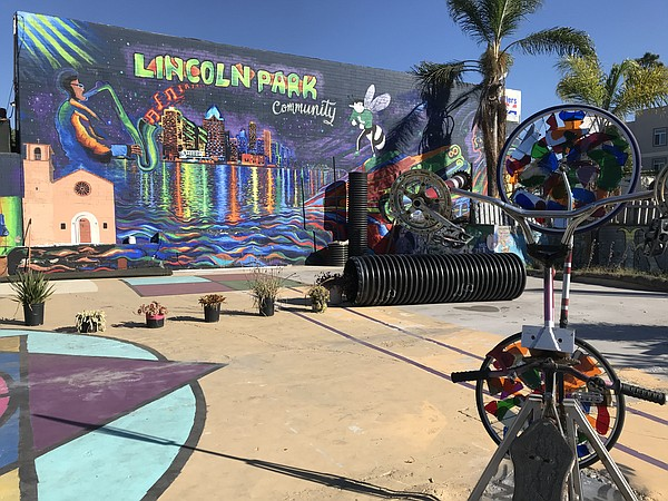 A mural is seen decorating the Lincoln Park community gat...