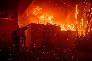 Firefighters Battle California Blazes Before Windstorms R...