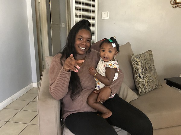 Ebony Palmer and her young daughter in her apartment in t...