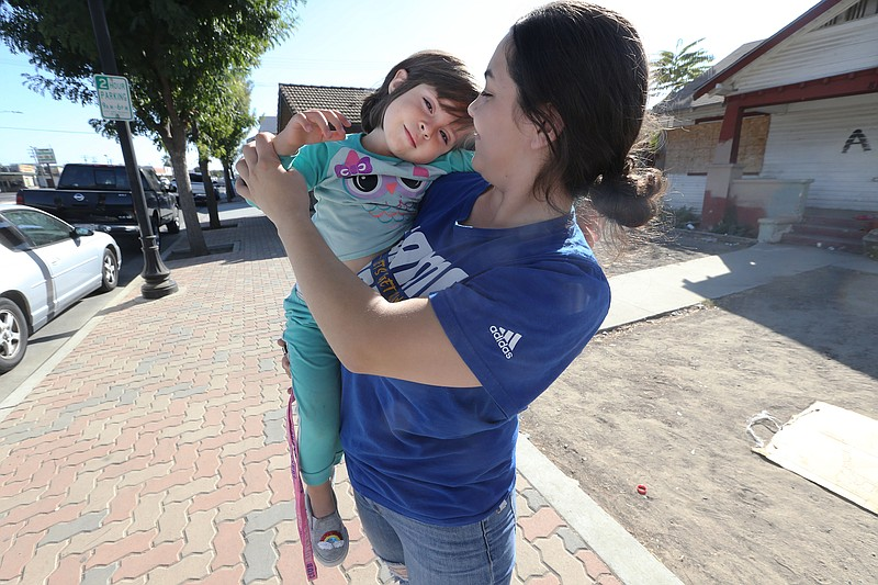 Diana Shalabi, 20, with her three-year-old, Amina, in Delano, California, in ...