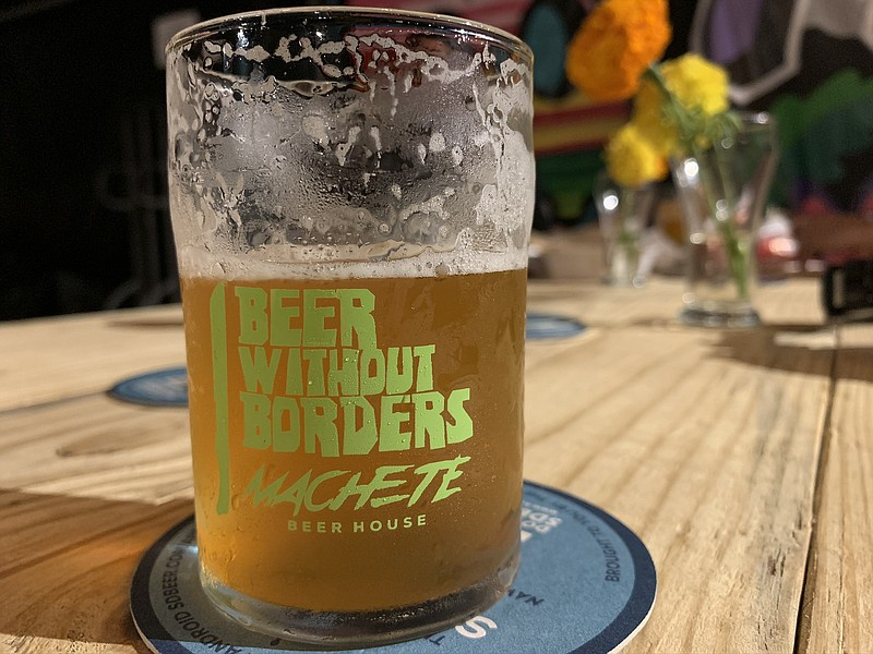 "A tasting glass from Machete Beer House's Nov. 2, 2019 ""Beer Without Borders"