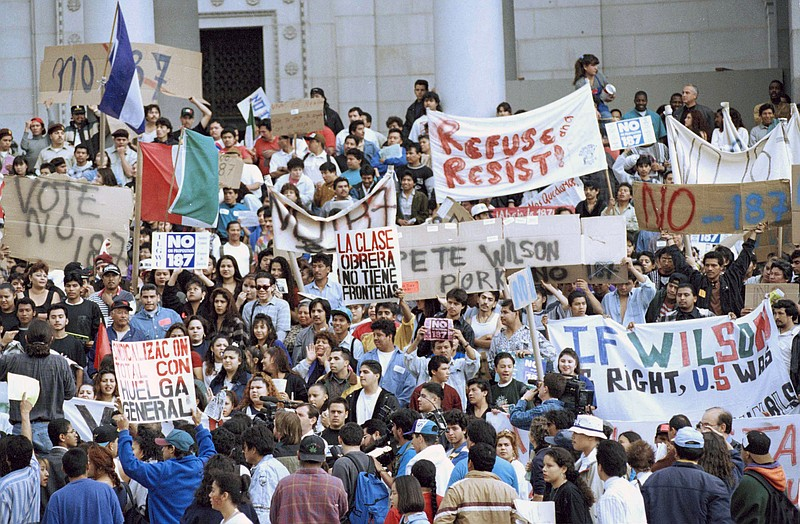 Hundreds of protesters gather at Los Angeles City Hall, Nov. 7, 1994, demonst...