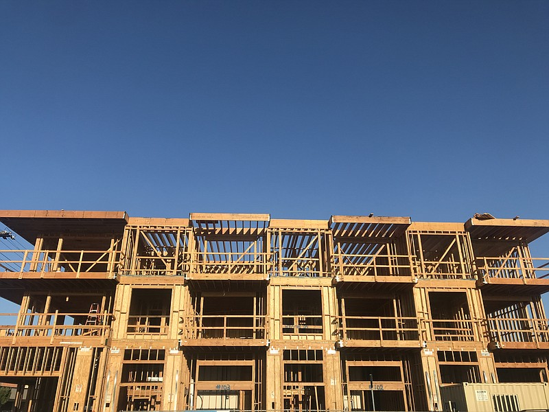 The wood framing of a new apartment building goes up in North Park, Sept. 23,...