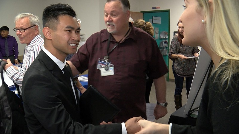 U.S. Marine Veteran Patrick Cagas meets with employers in Oceanside, Nov. 11,...