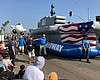 The USS Midway Museum float rolling down Harbor...