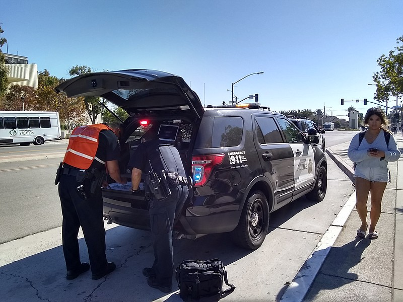 San Diego State University police prepare to direct traffic due to a power ou...