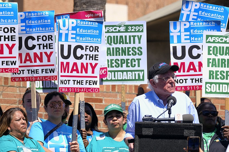 Vermont Sen. Bernie Sanders talks to workers at a rally at the University of ...