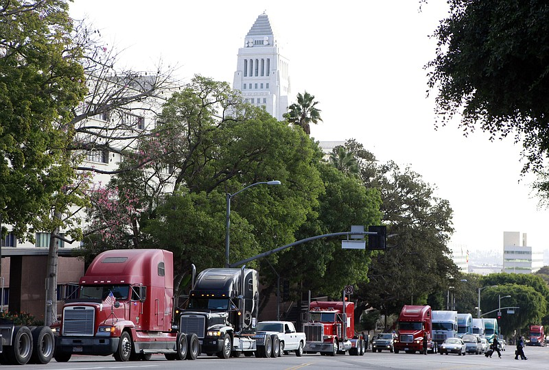 In this Friday, Nov. 13, 2009 file photo a caravan of trucks from the ports o...
