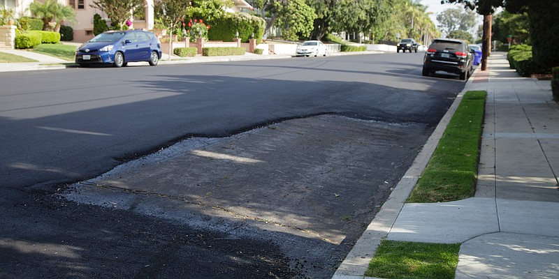 An unpaved section of road is seen on Brant Street in San Diego, where worker...
