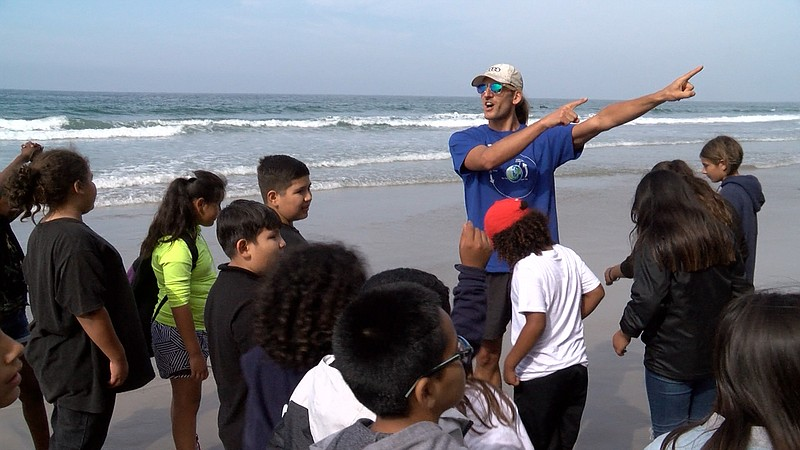 Students from schools throughout San Diego County meet with scientists from S...