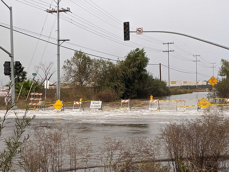 The flooded intersection of La Media and Airway roads in Otay Mesa following ...