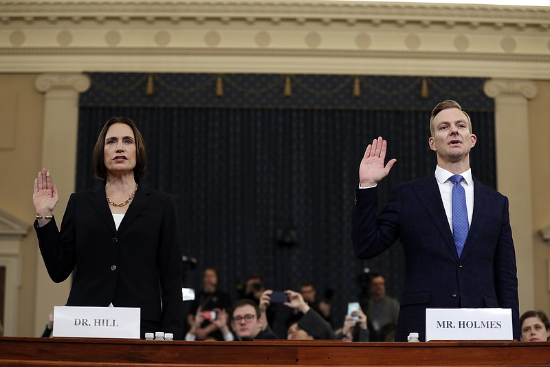 Former White House national security aide Fiona Hill, left, and David Holmes,...