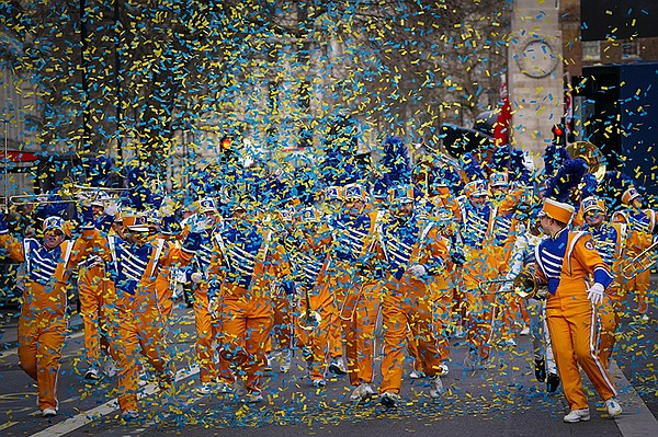 Marching band with exploding confetti at London's New Yea...