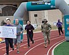 Runners participate in an domestic violence awa...