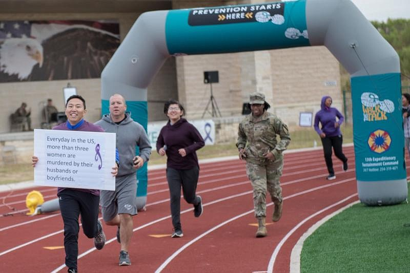 Runners participate in an domestic violence awareness event at Ft. Hood, Tex....