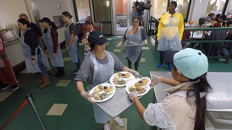 Volunteers serving Thanksgiving lunch at the Paul Mirabile Center hosted by F...