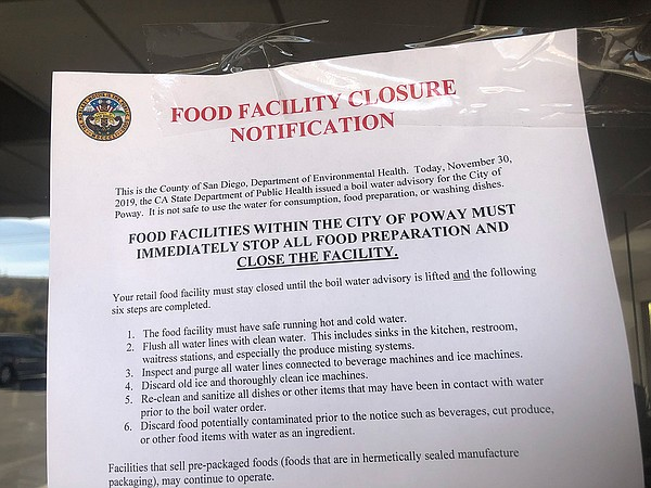 A notice of closure on the door of a Poway restaurant on ...