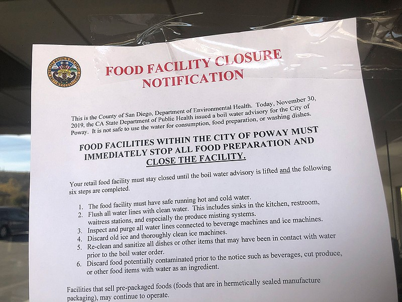 A notice of closure on the door of a Poway restaurant on Dec. 2, 2019, becaus...