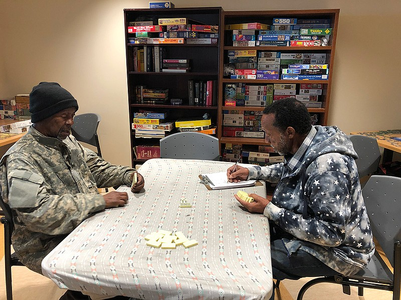 Two senior citizens enjoy a game of Dominoes at the Serving Seniors Wellness ...