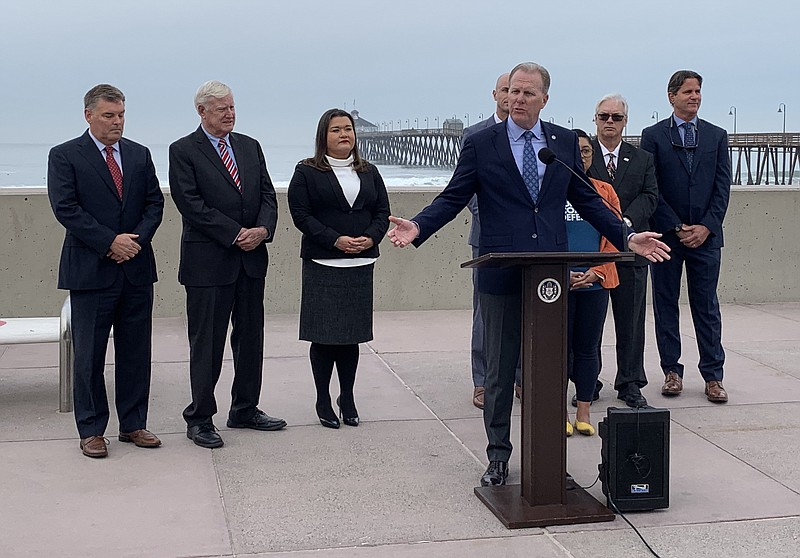 San Diego Mayor Kevin Faulconer flanked by Port of San Diego Commissioner Dan...