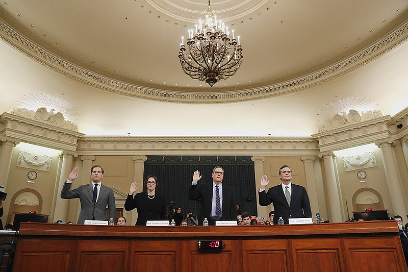 Constitutional law experts are sworn in to testify during a hearing before th...