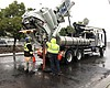 City workers pump sewers during a rainstorm in ...