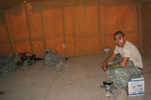 Jesus Medina rests in a tent with other soldiers in Iraq ...