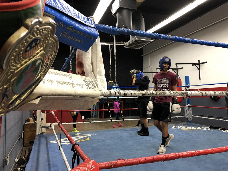 Alex Guillen steps into the ring while sparring in Calexico, California on De...