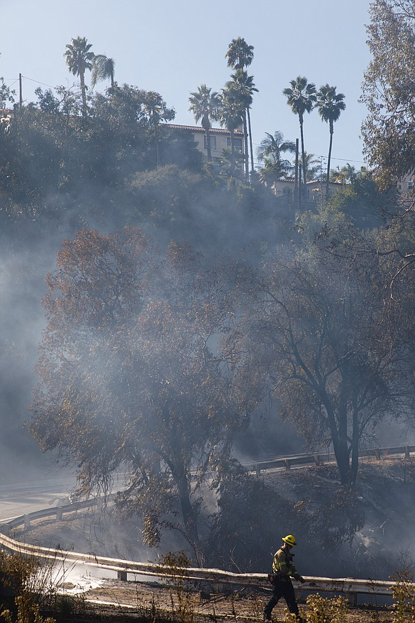 San Diego fire department crews put down a fire near Fair...