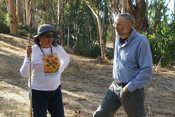 Oak Park residents Elida Chavez and Bruce Thompson walk t...
