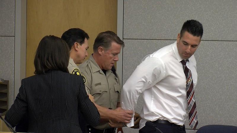 Former San Diego County sheriff's Deputy Richard Fischer being led away in ha...