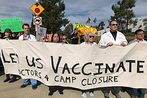 Doctors March On Border Patrol, Demanding It Vaccinates D...