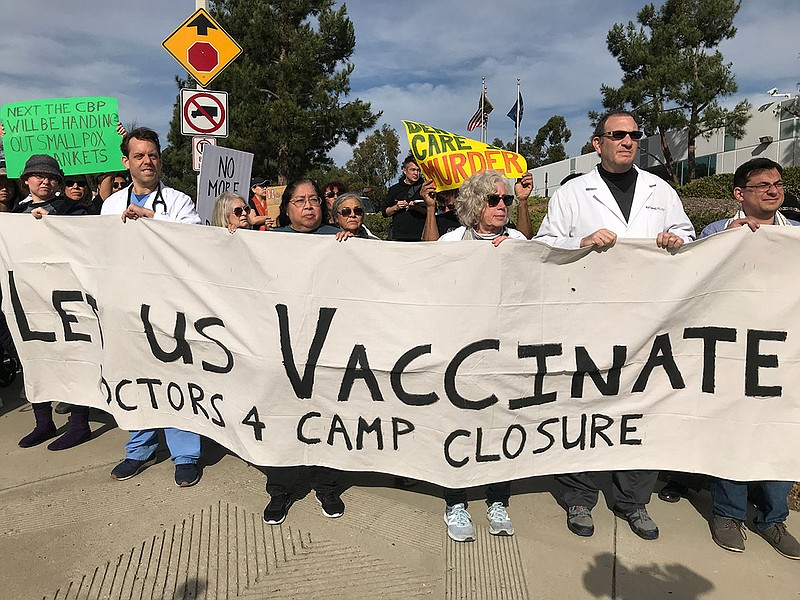 Doctors protest in front of Border Patrol Headquarters in Chula Vista, Califo...