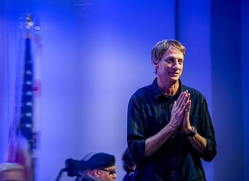 Skateboard legend Tony Hawk acknowledges the crowd after being recognized at ...