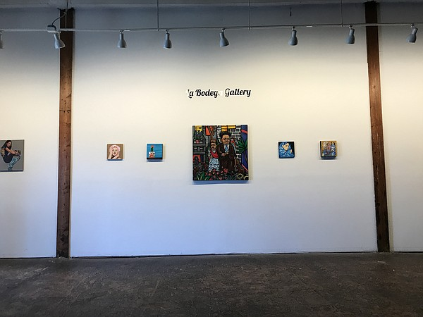 Art hangs on a wall at La Bodega Art Gallery in this phot...