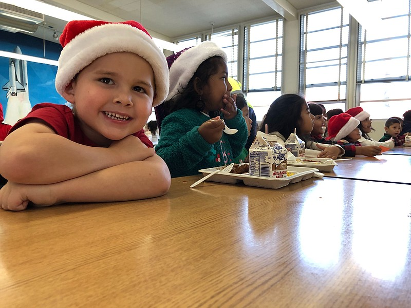 Students eat lunch at Edison Elementary school in City Heights, San Diego, De...