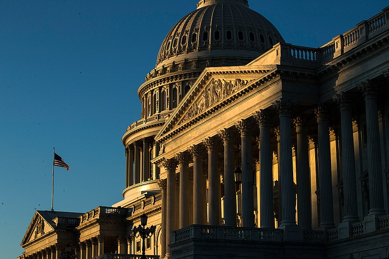 The U.S. Capitol building is illuminated by the rising sun, Wednesday, Dec. 1...