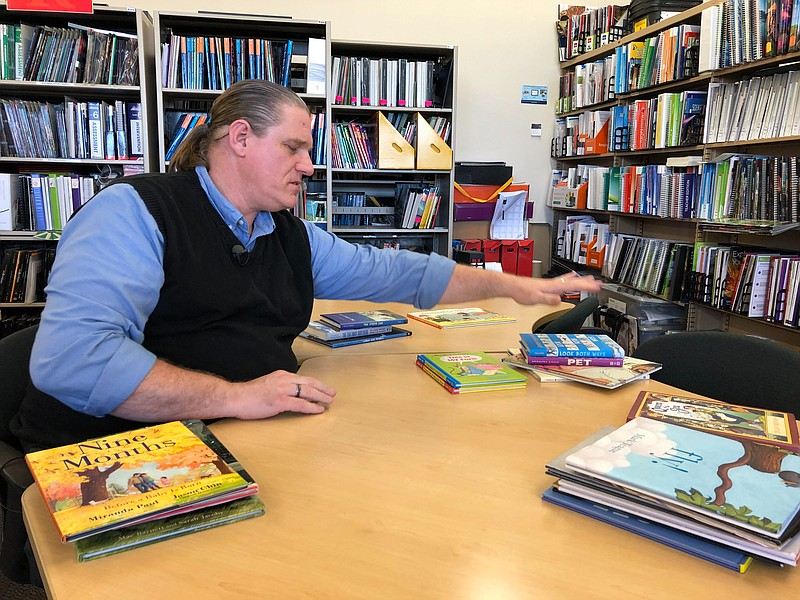 Jonathan Hunt is surrounded by his 2019 top picks for children and young-adul...
