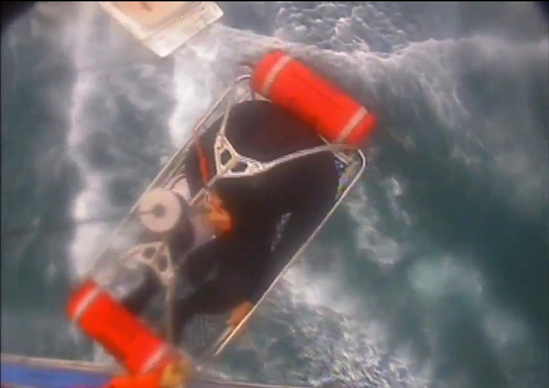 Video image released by the U.S. Coast Guard shows a man, wearing a full-body...