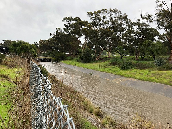 Water flowed through Chollas Creek after heavy rainfall, ...