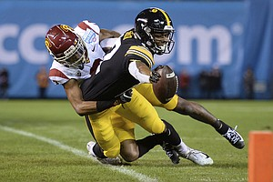 Photo for Smith-Marsette Has 3 TDs, Iowa Beats USC In Holiday Bowl