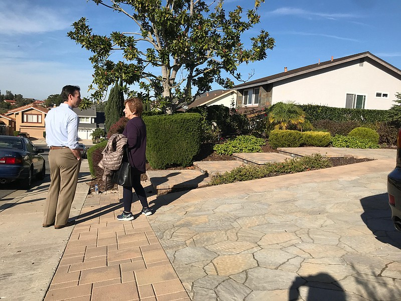 San Diego City Councilman Mark Kersey speaks to a resident about sidewalks, J...