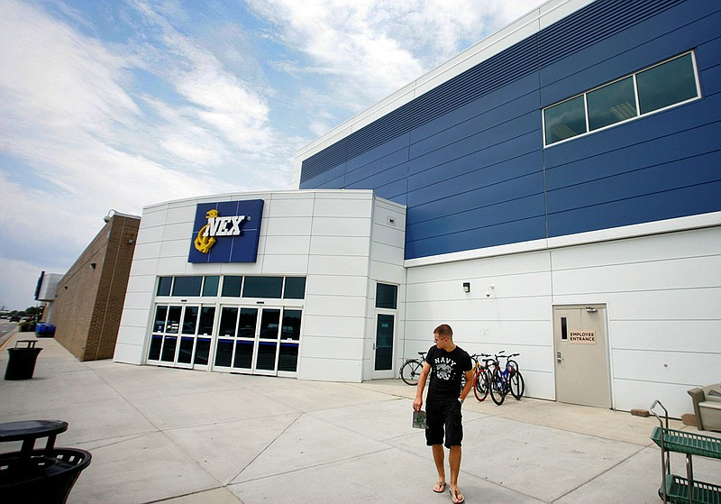 A  sailor walks out of Naval Station Norfolk Main Exchange, Wednesday, July 3...