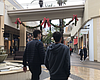 Shoppers walk around the Fashion Valley Mall in...