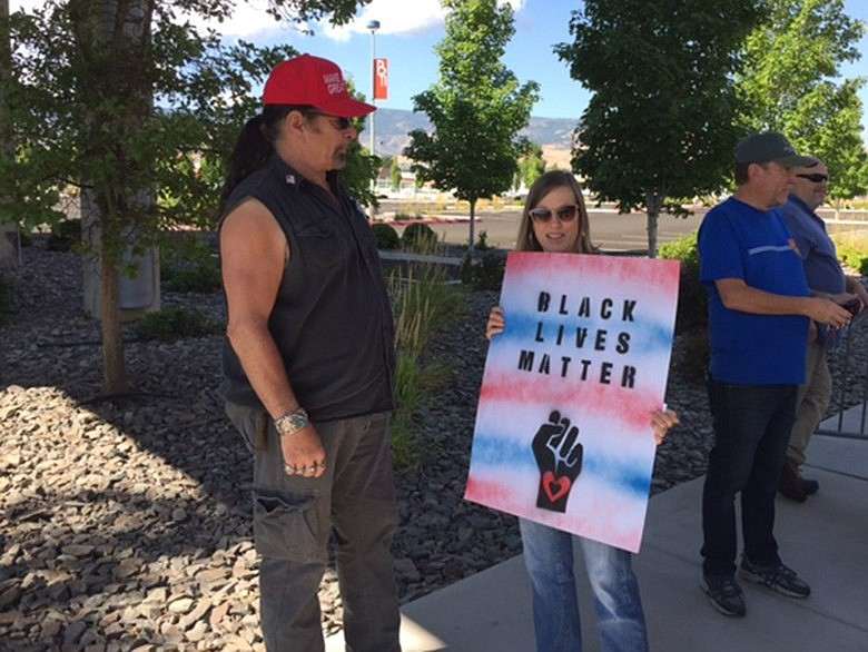 Trump supporter Kevin Coffey and protester Cathy Blane, both of Reno, chat ou...