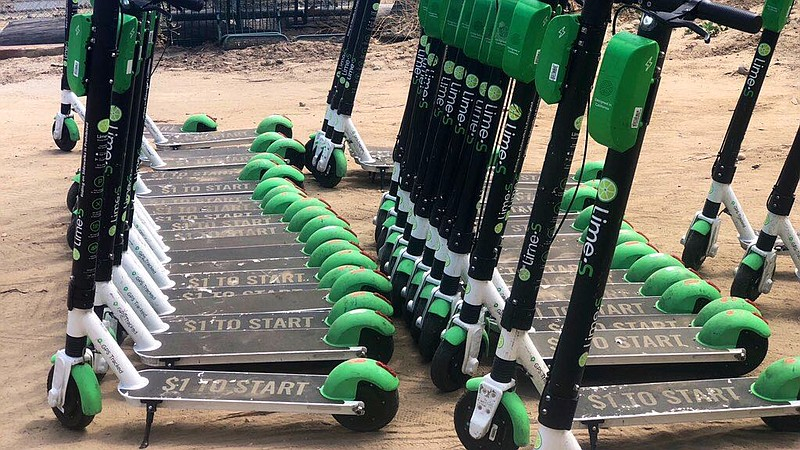 A group of Lime scooters are parked in preparation for removal from San Diego...