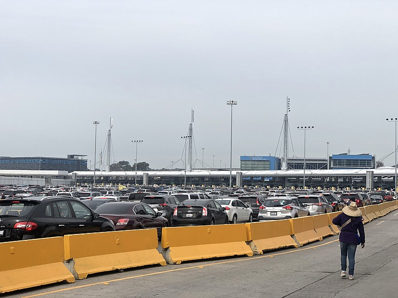 Cars wait in traffic at the San Ysidro Port of Entry in this photo taken in D...